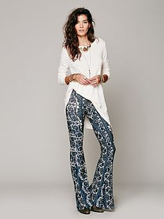 Border Print Bell Bottoms | Handmade printed pull-on bell bottom pants in a rustic color combo. Stretchy elastic waist band. Fabric is lightweight with easygoing stretch.  *By Novella Royale  *The fabric from each piece is hand cut from recycled fabric, making each piece limited and unique. Reduce. Re-use. Recycle..