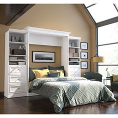 All surfaces of this beautiful bed feature a durable scratch-, stain- and burn-resistant melamine finish. The kit comprises the Queen Wall Bed and two 25-inch storage units with three drawers each. The mechanism provides simplified assembly.