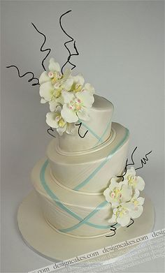 Topsy turvy wedding cake topped with orchids by Design Cakes, via Flickr