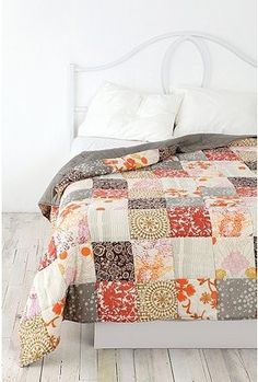 mix of earthy tones quilt with grey backing