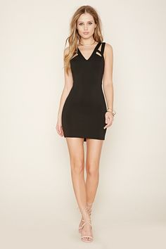 A scuba knit mini dress with strappy-cutout accents on its front and back, a bodycon silhouette, a concealed back zipper, and a V-neckline.