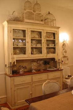 I have the perfect place in my kitchen for an old dining hutch like this. dear garage sales, please have one waiting for me next summer :) maybe in a distressed red or teal though chard this looks like something you would love :) Furniture Makeover, Furniture Projects, Home Projects, Vintage Hutch, Antique Hutch, Dining Hutch, Dining Room, Kitchen Dresser, Living Vintage