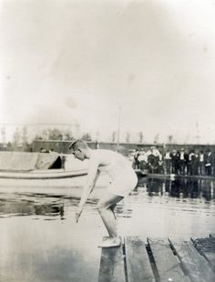 E. Rausche of Germany, winner of the one mile swimming championship, ready to start at the 1904 Olympics.