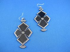 Items similar to black enamel cross dangle earrings with crown detail and light gray rhinestone accents with silver plated earring backs on Etsy Earring Backs, Black Enamel, Silver Plate, Dangle Earrings, Dangles, Detail, My Style, Trending Outfits, Unique Jewelry