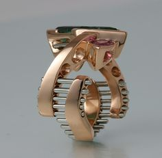 Ring | Jimi Gwinn.  18k rose gold, platinum accents, pink sapphires and a green tourmaline cut by John Dyer.