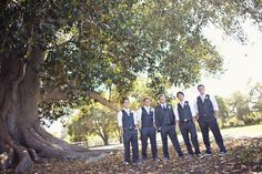 groomsmen vests but with groom in gray and teal vest only