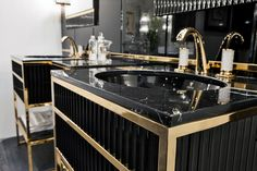 academy luxury bathroom collection features Deco design inspiration in hand made vanities, cabinets and accessories, marble tops, geometric decorations and metal details