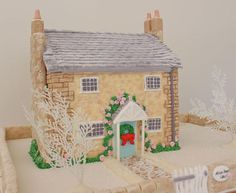 This little cottage was made for a Christmas in July display at Fountaindale Manor, Robertson NSW Australia. All of the decorations are sugar, and the house is made on a styrofoam base.