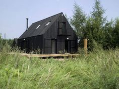 Simple black stained country house near Moscow