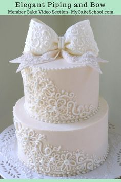 This beautiful cake features elegant buttercream piping and a lovely bow! Perfect for weddings, anniversaries, bridal showers, and more! MyCakeSchool.com