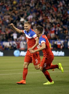 Aron Johannsson #9 and Matt Besler #5 of the United States celebrare after Johannsson scored a goal against Azerbaijan during their match at...