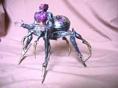 Spinstress, based on the idea of Arachne from greek myth... but centaur-spider is a cool idea... and the robot mode does NOT use the same torso, but suffers from a huge backpack issue