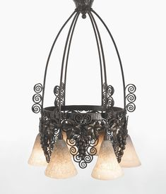 EDGAR BRANDT AND DAUM SIX-LIGHT CHANDELIER each shade engraved DAUM NANCY FRANCE with the Croix de Lorraine mount impressed FRANCE/E. BRANDT patinated wrought iron and glass 34 1/4  in. (87 cm) high 22 5/8  in. (57.5 cm) diameter circa 1925