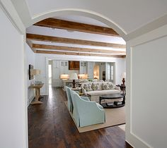 Oil-stained wide plank pine floors and beams...