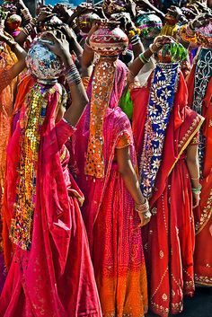 Rajasthani women on parade during the Pushkar Camel Fair in the state of Rajasthan, India.  So pretty  -  bucket list?