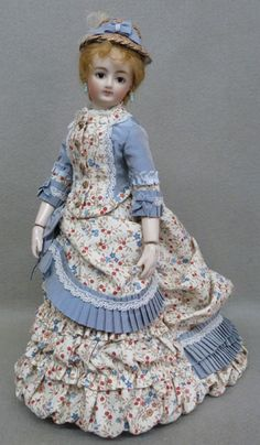 Pretty cotton and silk dress with straw bonnet.