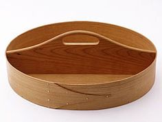 """$56 Shaker 2-sided oval carrier.   13 1/2"""" x 9 1/4"""" x 2 3/4"""" high"""