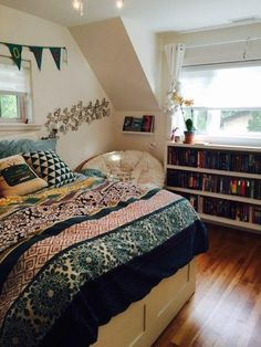 I love this bedroom with all of the books and the boho bedspread. #boho