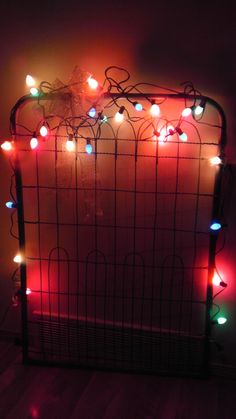 Old metal gate dressed up for holidays. Cute!