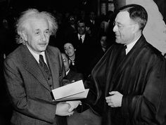Becoming a United States citizen in 1940 #alberteinstein   Albert Einstein is congratulated by Judge Phillip Forman after receiving his certificate of American citizenship during a ceremony held in Trenton, New Jersey on October 1, 1940. (Photo: Al Aumuller/Library of Congress)