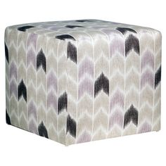 Add a pop of pattern to your living room or den with this chic ottoman, perfect for resting a tray of cocktails or offering an extra seat in the den.