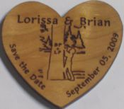 Another 'save the date' idea. Engraved cherry wood magnets.