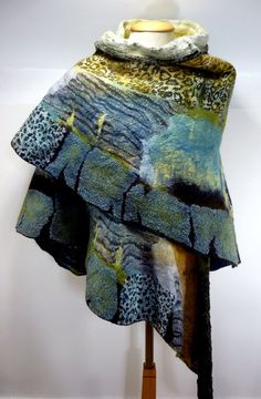 PLEASE NOTE THIS ITEM HAS BEEN RESERVED FOR ETSY BUYER JANETANDROBERTA! If you are interested in commisioning me for a similar wrap, please get in touch.      This is a unique and one-off-a-kind hand felted nuno felt wrap loosely modelled on the wings of the Owl butterfly from Central America.    Totally quirky and sure to attract lots of attention, this wrap can be worn in lots of different ways and looks very dramatic when worn. It was made to go with the Metamorphosis head dress which is…