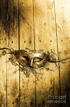 Spotlight on golden masquerade Venetian carnival mask with variety of scattered keys on wooden surface, theater concept by Jorgo Photography - Wall Art Gallery