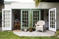 love the outdoor ease ...Outbuilding of the Week: The 186-Square-Foot Guest Cottage Garage Renovation, Garage Remodel, Garage Makeover, Cabana, Garage Guest House, Converted Garage, Tiny Living Rooms, Double French Doors, Garage Apartments