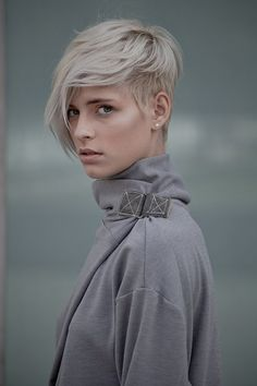 Nice asymmetric cut. I like the pixie shortness of the one side with a little longer on top. Maybe this instead? Brown of course.