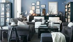 Grey Sofa Living Room Design Ideas with black table and blue wall color