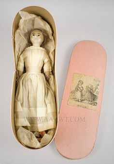 """Doll, Wax Head, Original Box and Clothing       Glass eyes and cloth body; remaining in good condition.  Dimensions: 13"""" H.    $800.00"""