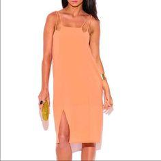 Pastel side slit midi slip dress Pastel orange lightweight midi sundress with side slit and adjustable double shoulder straps.  Sizes S/M/L Runs slightly large Dresses Midi