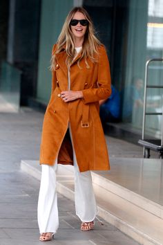 27 May Elle Macpherson was spotted in London wearing white  tailored trousers and a suede coat.   - HarpersBAZAAR.co.uk