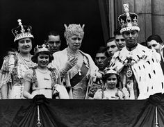 Truely History:  May 12, 1937, The Royal family wave from the balcony at Buckingham Palace after the coronation of King George VI (Queen Elizabeth II father). From left to right): Queen Elizabeth (Queen Elizabeth II mother); Princess Elizabeth; Queen Mary the Queen Mother; Princess Margaret; and King George VI.
