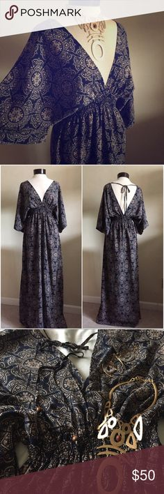 Goddess Maxi Dress Gorgeous Greek goddess style maxi dress. Beautiful pattern of the fabric. New in perfect condition but tag was removed. Empire waistline is smocked and stretchable. Skirt has slits on both sides. Rue21 Dresses Maxi