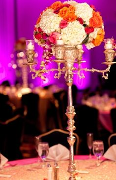 centerpieces indian weddings - would like this is flowers were less in a ball, freer (vines hanging)