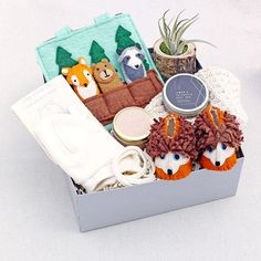 Our Woodland Celebration curated baby gift box celebrates the arrival of new baby with fair-trade, handmade goods and relaxing essential oils goodies for the entire family.