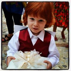 my handsome ring bearer who practiced for months to carry the ring: just adorable!