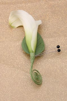 The boutonnieres and corsage were made from mini calla lilies