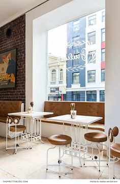 Bright and clean cafe with white tables and leather chairs Italian Cafe, Food Industry, Good Company, White Tables, City Life, Cape Town, Leather Chairs, Dining Table, Van