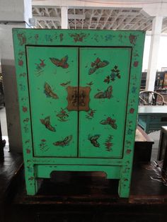 Asian Inspired Storage Cabinet Green with Butterflies (Los Angeles). $599.00, via Etsy.