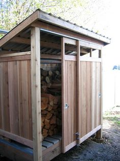Firewood shed built with reclaimed materials. - modern - Garage And Shed - Seattle - Cedarcraft construction LLC