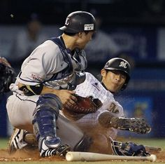 Lions catcher Ginjiroh Sumitani successfully blocks the plate and applies the tag to Takashi Ogino for the 2nd out of the 3rd inning at QVC Marine Field on Wednesday, August 8, 2012.