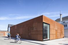 City Library Bruges' new rusty facade gets more beautiful over time | Inhabitat - Sustainable Design Innovation, Eco Architecture, Green Building