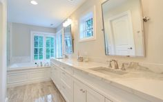 Traditional Master Bathroom with Undermount Sink, Double sink, Master bathroom, High ceiling, limestone tile floors, Flush