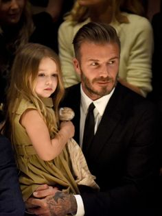 The Beckham family sits front row at Burberry's LA show. See all the adorable photos here: