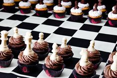 Chocolate Chess Piece Cupakes (Note: Making chocolate pieces, such as these, is super easy and can be made from chocolate chips melted in a microwave and poured into a mold, just google up on it and go for it!)