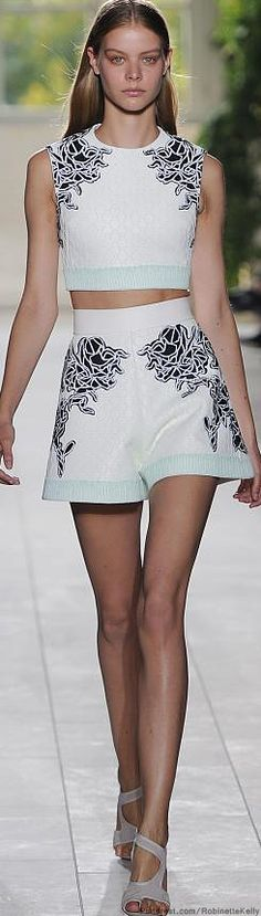 Wow! I wasn't sure I wanted to revisit early 90's high waists and crop tops, but this dress is awesome and would look good on a lot of people. Balenciaga | Spring / Summer 2014