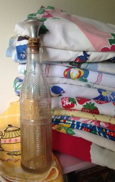 """Soda bottle used to sprinkle water on clothes when ironing. Found in the garage of my """" new"""", old house.My mom used this when I was young. Aprons Vintage, Vintage Tablecloths, Granny Chic, Soda Bottles, Kitchen Items, Linen Bedding, Vintage Looks, Tea Towels, Laundry Room"""